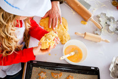 Family baking Christmas cookies in kitchen Royalty Free Stock Photography