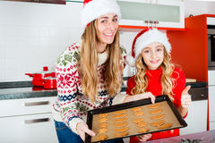 Family baking Christmas cookies in kitchen Royalty Free Stock Images