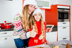 Family baking Christmas cookies in kitchen Stock Photo