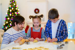 Family baking on Christmas eve Royalty Free Stock Images