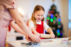 Family baking on Christmas eve Stock Images