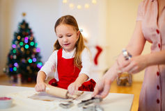 Family baking on Christmas eve Royalty Free Stock Photos