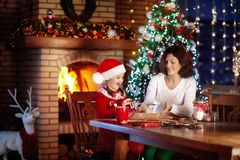 Family baking at Christmas. Mother and child bake. Stock Images