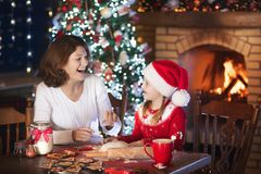 Family baking at Christmas. Mother and child bake. stock photo