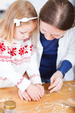 Family baking cookies Stock Images