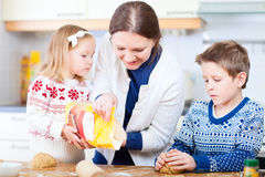 Family baking cookies Stock Photography