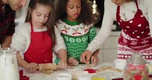 Family baking cookies for Christmas