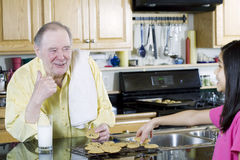 Family baking cookies together Stock Photos
