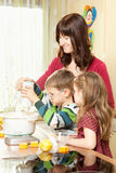 Family is baking cookies Royalty Free Stock Photography