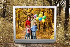 Family with balloons in autumnal park in unreal tv. Family of four with balloons and Footpath among yellowed trees in autumnal park in unreal tv screen collage Stock Photo