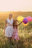 Family with balloons outdoor Stock Photography