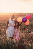 Family with balloons outdoor Royalty Free Stock Photos