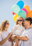 Family with balloons outdoors Royalty Free Stock Photo
