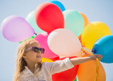 Family with balloons outdoors Royalty Free Stock Photography