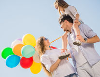 Family with balloons outdoors Royalty Free Stock Photos