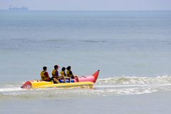 Family on Banana Boat royalty free stock photos