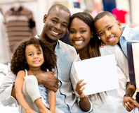 Family with a banner at a store Stock Image