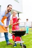 Family barbecue in garden home Royalty Free Stock Photos