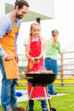 Family barbecue in garden home Royalty Free Stock Images