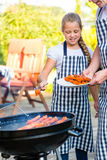 Family barbecue together on terrace Royalty Free Stock Photo