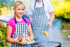 Family barbecue together on terrace Royalty Free Stock Photography