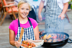 Family barbecue together on terrace Stock Images