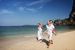 Family Barefoot Beach Enjoying Vacation Leisure Concept Stock Photo