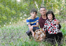 Family with a basket of mushrooms Royalty Free Stock Images