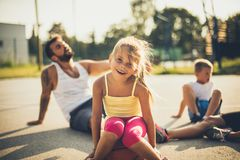 Family after basketball game. Focus on little girl. Family after basketball game. Focus on happy little girl stock photos