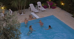 Family bathing in the swimming pool stock video