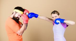 Family battle. Man and woman in boxing gloves. Boxing sport concept. Couple girl and hipster practicing boxing. Sport royalty free stock photo
