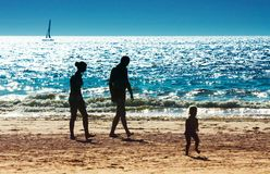 A family on the beach Stock Images