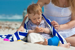 Family on a beach. Child and mother on a beach Stock Images