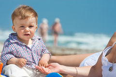 Family on a beach. Child and mother on a beach Royalty Free Stock Image