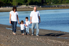 Family at beach Stock Images