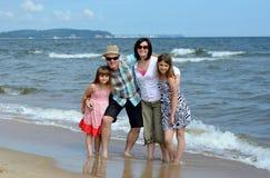 Family on the beach. Happy family on summer beach Stock Photos