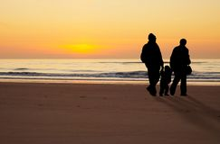 Family at the beach. On a beautiful night Stock Photos