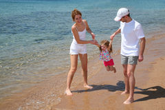 Family on beach. Family with child on beach stock images