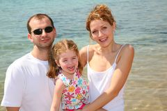Family on beach. Family with child on beach royalty free stock images