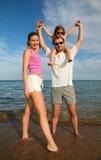 Family on a beach Stock Photos