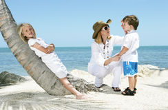 Family on the beach. A young woman with two children relaxing in a tropical area Royalty Free Stock Photography