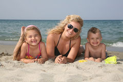 Family at the beach. Happy family having holiday at the beach royalty free stock images