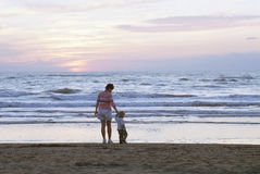 Family on a beach. Mother and child on a beach royalty free stock photo