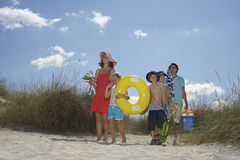 Family With Beach Accessories Royalty Free Stock Image