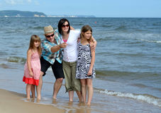Family beach attractions. Happy family on summer beach Stock Photography