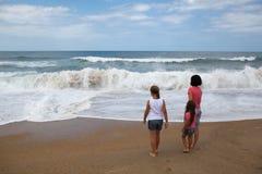 Family on the beach Stock Photo