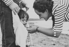 Family on the beach. Black and white. Royalty Free Stock Photos
