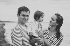 Family on the beach. Black and white. Stock Images