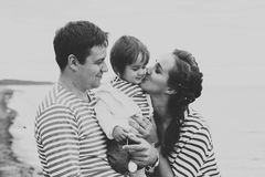 Family on the beach. Black and white. Royalty Free Stock Photo