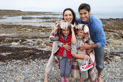 Family on beach with blankets Royalty Free Stock Image